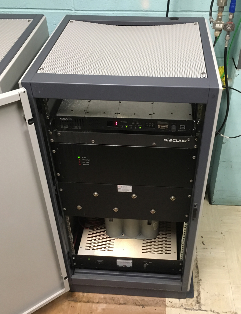 Complete two-way radio conventional repeater system in cabinet
